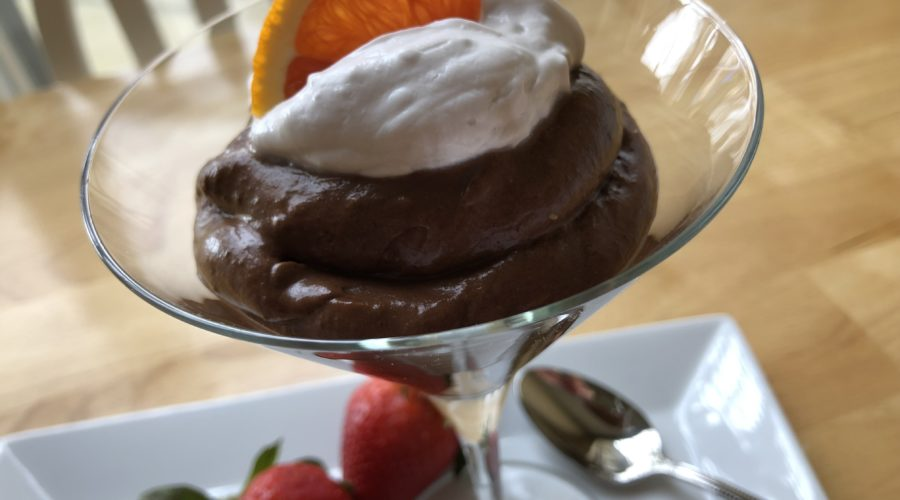 healthy dark chocolate mousse recipe garnished with strawberries and orange
