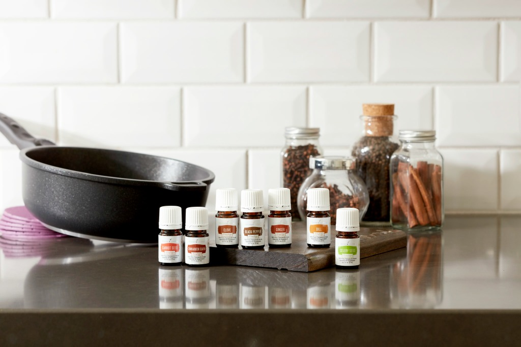 cooking with vitality essential oils in the kitchen white background