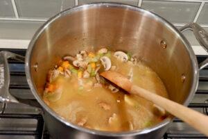simmering vegetables in broth